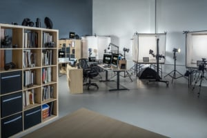 Commercial photographer in Woodbridge VA. Photo shows the main photography studio area where small and large products and people can be photographed. In the background are three light cubes for product photography on white.