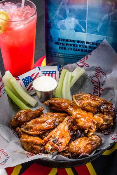 Photo shows a glass of lemonade, buffalo wings and dipping sauce for a national chain of restaurants. Photographed for editorial use for Prince William Living magazine.