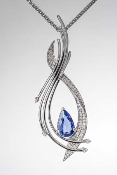 Photo shows a photograph of a tanzanite and diamond pendant.