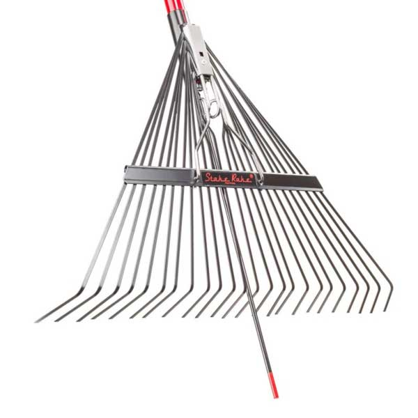 Photo shows the end of a leaf rake with an extra extension so it can stand on it's own when inserted into the ground.