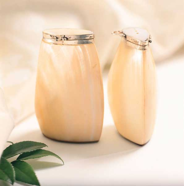 Photo shows a product photo of pearl finished salt and pepper shakers.