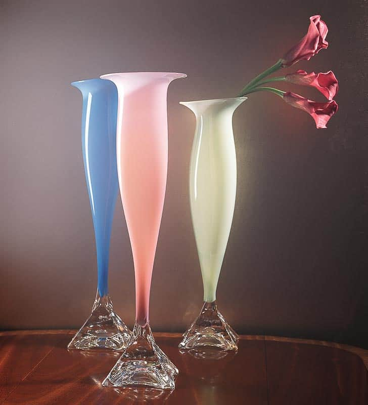 Photo shows blue, pink, and mint green handblown glass vases for online retailer.