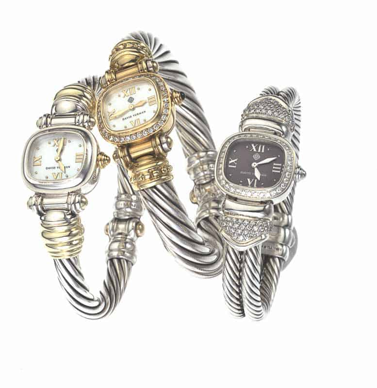 Photo shows three watches designed by David Yurman photographed on white.