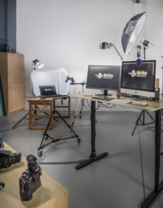 Commercial photography studio in Woodbridge. Photo shows the main computer workstation area with a tabletop setup just behind it.