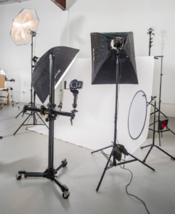 Photo shows photo studio area that can be converted for photographing models at full length or large products on white.