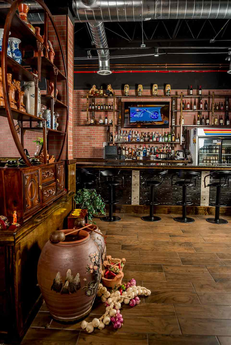 Photos show interior of a Vienamese restaurant.