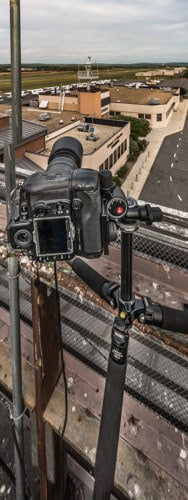 Photo shows camera setup on top of a building amongst pigeon dung.