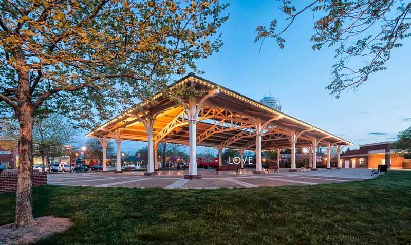 Photo shows a dusk photo of the Harris Pavilion in Manassas, VA