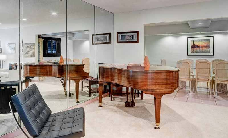 Photo shows the piano room of a rental home.