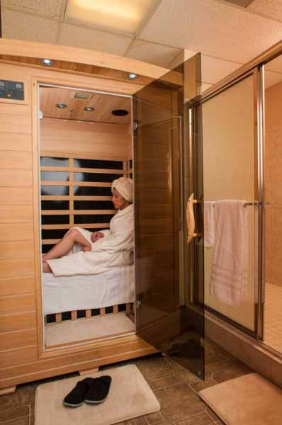 Photo shows a woman in a sauna as part of the services offered by a massage therapist.
