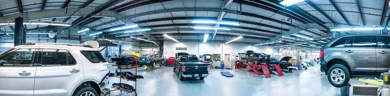Photo shows an 360˚ panorama of a repair facility interior.