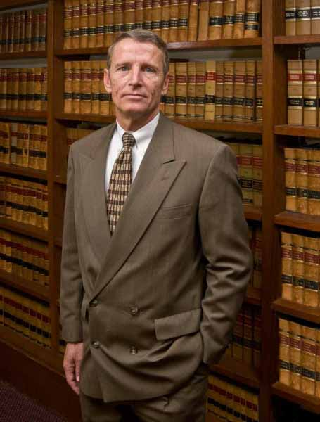 Photo shows an attorney posing for an environmental portrait.