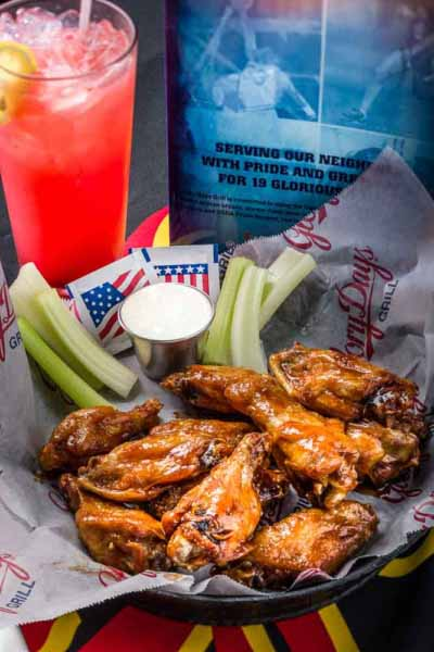 Photo shows a glass of lemonade and a plate of buffalo wings shot for Prince William Living magazine.
