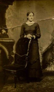 Before Photo Restoration of a woman posing next to a chair