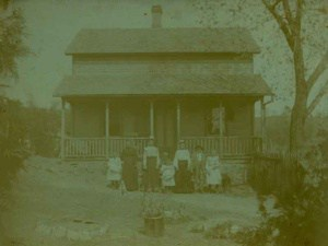 Before Photo Restoration of a very old home with a family in front